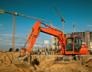 Cority Read UCOR case study - photo of an orange excavator inside construction site