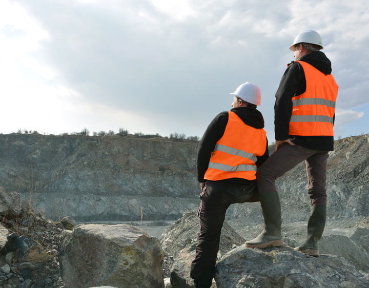 Read Westmoreland-Coal/Cority case study - photo of two miners with hard hats facing out