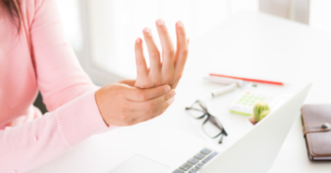 Woman holding their wrist in pain